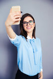 Smiling businesswoman making selfie photo Stock Image