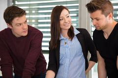 Smiling Businesswoman With Male Colleagues In Office Royalty Free Stock Photography