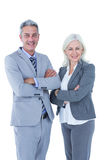 Smiling businesswoman and man with arms crossed Stock Photo