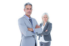 Smiling businesswoman and man with arms crossed Royalty Free Stock Images