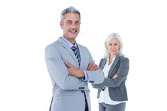 Smiling businesswoman and man with arms crossed Royalty Free Stock Image
