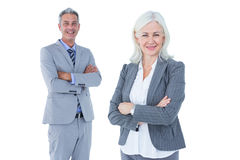 Smiling businesswoman and man with arms crossed Royalty Free Stock Photography