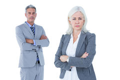 Smiling businesswoman and man with arms crossed Royalty Free Stock Photo