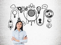 Smiling businesswoman with a marker and startup sketch Stock Images
