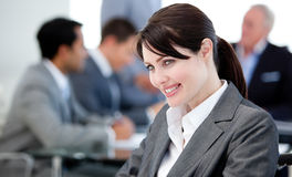 Smiling businesswoman in a meeting Royalty Free Stock Photos