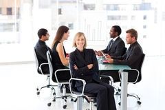 Smiling businesswoman in a meeting Stock Images