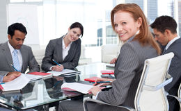 Smiling businesswoman in a meeting with her team Stock Images