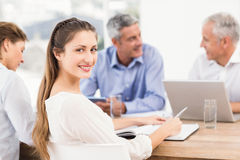 Smiling businesswoman during a meeting Royalty Free Stock Images