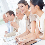 Smiling Businesswoman in a Meeting Royalty Free Stock Image