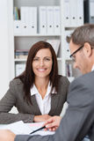 Smiling businesswoman in a meeting Royalty Free Stock Photography