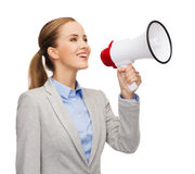 Smiling businesswoman with megaphone Stock Photo