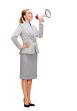 Smiling businesswoman with megaphone Royalty Free Stock Image