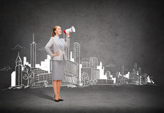 Smiling businesswoman with megaphone Stock Images