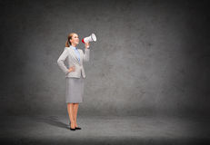 Smiling businesswoman with megaphone Stock Image