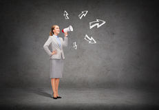 Smiling businesswoman with megaphone Royalty Free Stock Photo