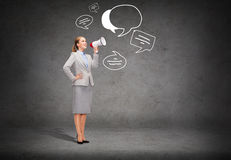 Smiling businesswoman with megaphone Royalty Free Stock Photos