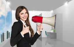Smiling businesswoman with megaphone Stock Photography