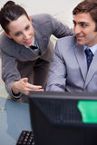 Smiling businesswoman mentoring her new colleague Stock Images