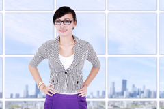 Smiling businesswoman at modern office Stock Photo