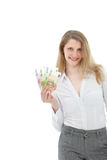 Smiling businesswoman with money Stock Photo