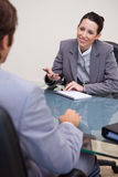 Smiling businesswoman with notepad in negotiation Royalty Free Stock Photography