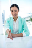 Smiling businesswoman offering a handshake Royalty Free Stock Photography
