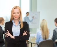 Smiling businesswoman at office Royalty Free Stock Images