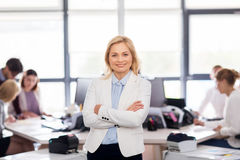 Smiling businesswoman at office Royalty Free Stock Photos