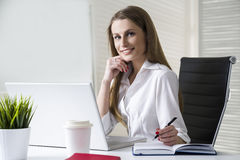 Smiling businesswoman in office Royalty Free Stock Photo