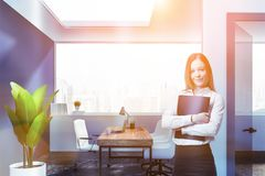 Smiling businesswoman in office lobby stock image