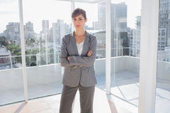 Smiling businesswoman in office Stock Images