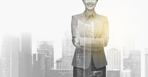 Smiling businesswoman over city buildings Royalty Free Stock Images