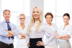 Smiling businesswoman over office team Royalty Free Stock Photos