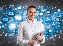 Smiling businesswoman over technology background Royalty Free Stock Image