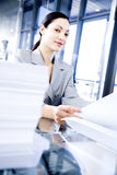 Smiling businesswoman with paperwork Stock Image