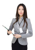 Smiling businesswoman with pen and clipboard Stock Image