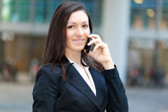 Smiling businesswoman at the phone Royalty Free Stock Images