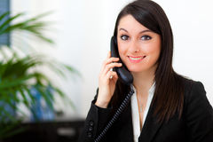 Smiling businesswoman at the phone Stock Image