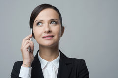 Smiling businesswoman on the phone Royalty Free Stock Images