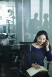 Smiling Businesswoman on the phone in office Royalty Free Stock Images