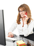 Smiling businesswoman on the phone in office Stock Images