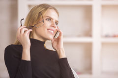 Smiling businesswoman on phone Stock Photo