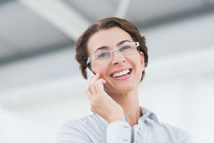Smiling businesswoman on the phone wearing eye glasses Stock Images