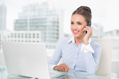 Smiling businesswoman phoning Stock Images