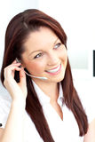 Smiling businesswoman phoning using headphones Stock Photography