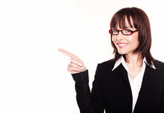 Smiling Businesswoman Pointing Stock Photo