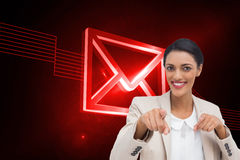 Smiling businesswoman pointing at the camera Stock Images