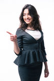 Smiling businesswoman pointing finger away Stock Photos