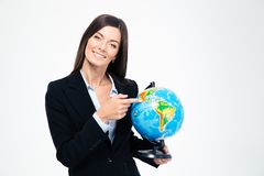 Smiling businesswoman pointing finger on globe Stock Image
