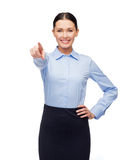 Smiling businesswoman pointing finger at you Stock Photography